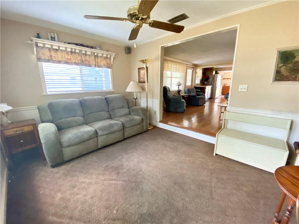 Florida Room, view to the living room. - Single Family Home for sale at 4300 Eastern Pkwy, Sarasota, FL 34233 - MLS Number is A4464200