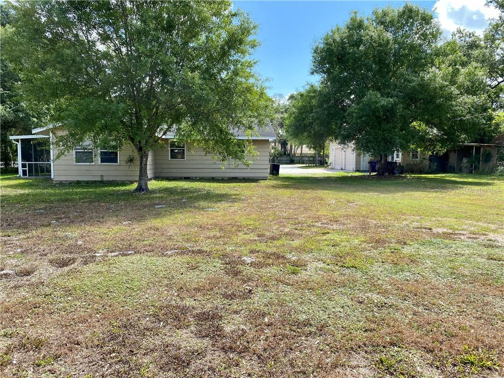 Closer view of the back yard.  House on the left and detached garage on the right. - Single Family Home for sale at 4300 Eastern Pkwy, Sarasota, FL 34233 - MLS Number is A4464200