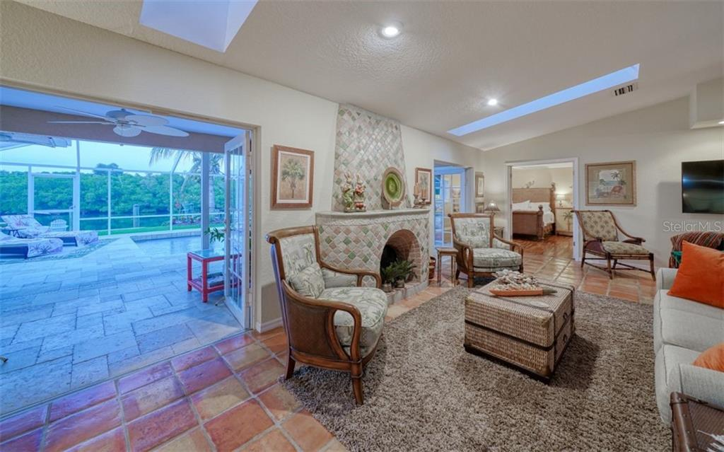 THE GREAT ROOM OPENS UP TO THE COVERED LANAI & POOL - Single Family Home for sale at 3 Winslow Pl, Longboat Key, FL 34228 - MLS Number is A4464990
