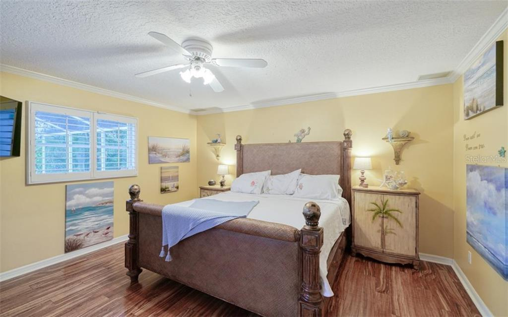 SOFT & RELAXING MASTER SUITE WITH DOUBLE DOORS TO THE POOL/ PATIO - Single Family Home for sale at 3 Winslow Pl, Longboat Key, FL 34228 - MLS Number is A4464990