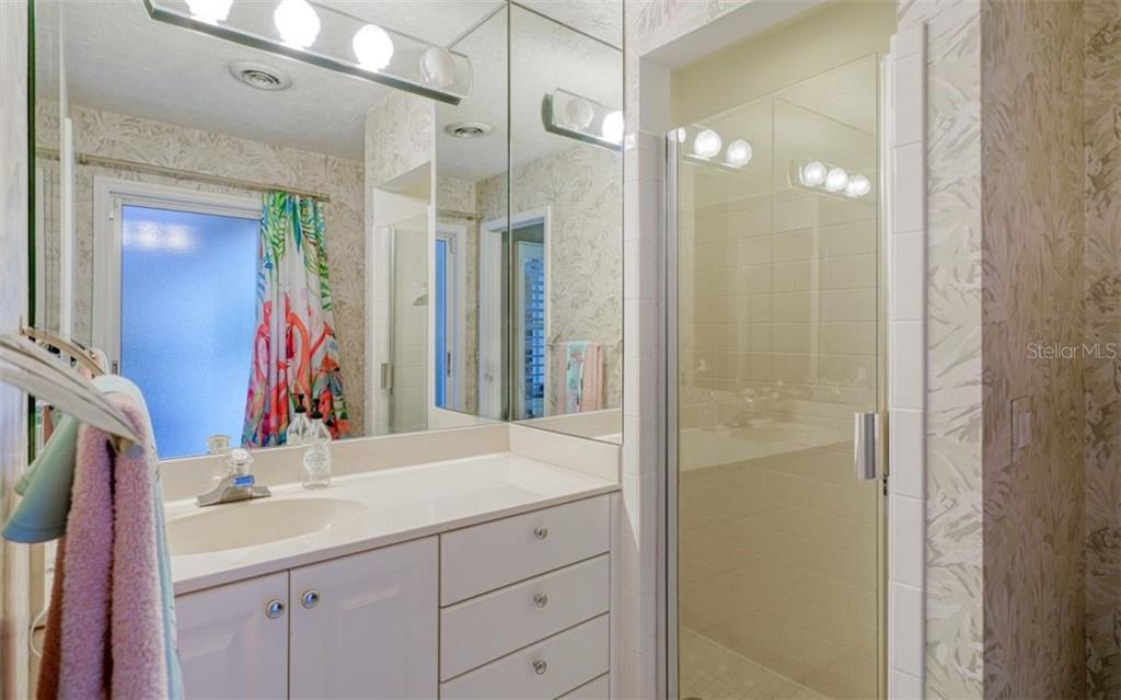 GUEST BATH & IT IS ACCESSIBLE FROM THE PATIO & POOL AREA - Single Family Home for sale at 3 Winslow Pl, Longboat Key, FL 34228 - MLS Number is A4464990