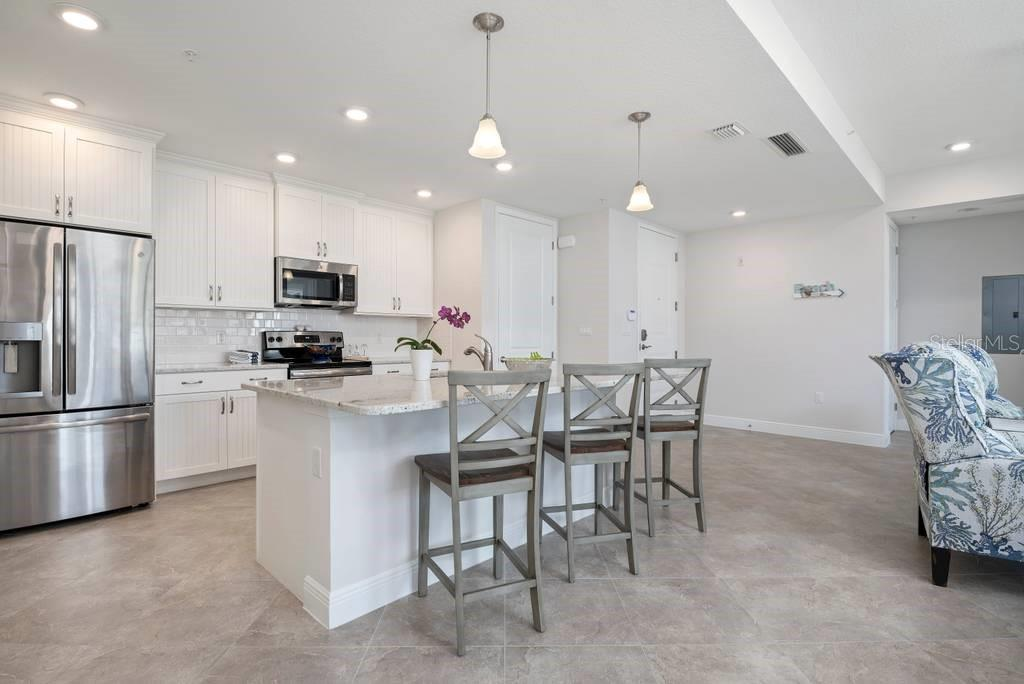 Kitchen with eat in breakfast bar - Condo for sale at 383 Aruba Cir #201, Bradenton, FL 34209 - MLS Number is A4466540