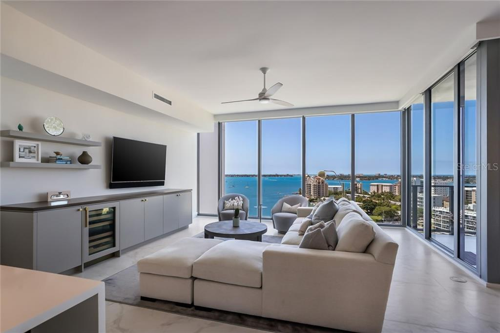 The stylish built-in also has a wine refrigerator. - Condo for sale at 1155 N Gulfstream Ave #1404, Sarasota, FL 34236 - MLS Number is A4467921