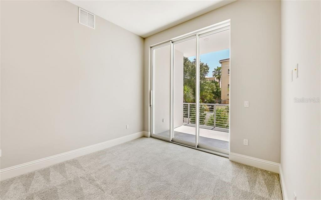Each secondary bedroom has its own private terrace. - Condo for sale at 609 Golden Gate Pt #201, Sarasota, FL 34236 - MLS Number is A4468917