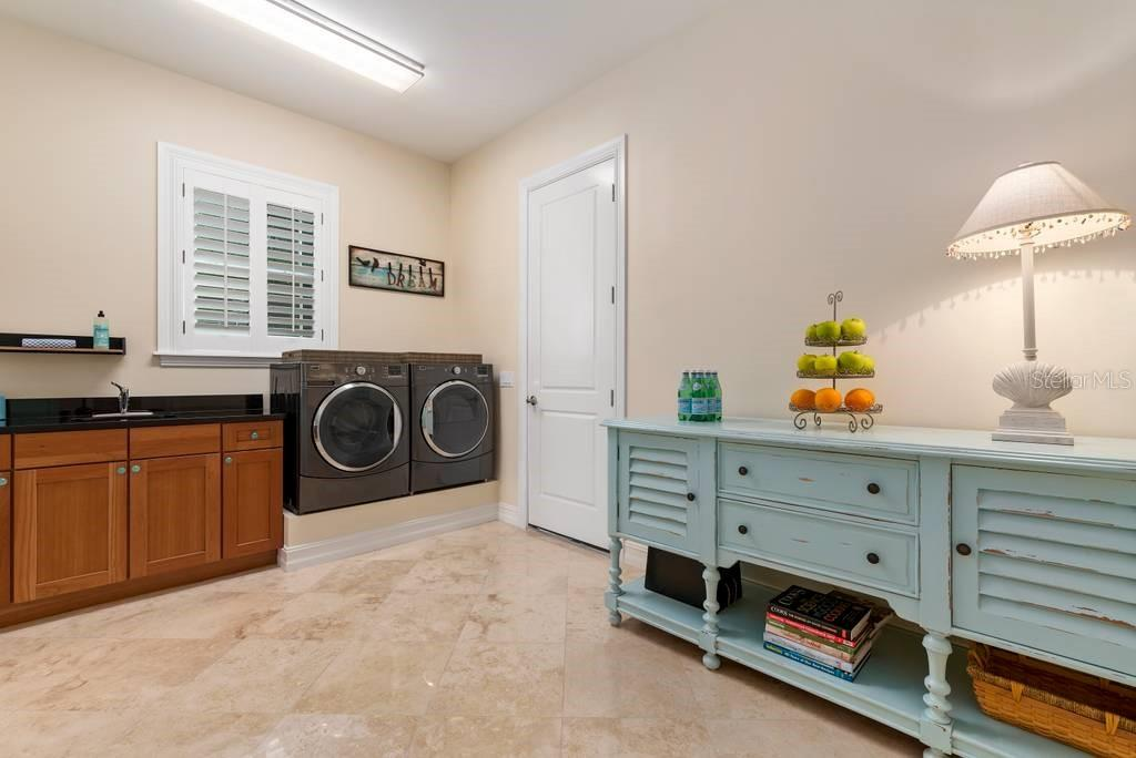 Laundry room and entry to 2 car garage - Single Family Home for sale at 605 N Point Dr, Holmes Beach, FL 34217 - MLS Number is A4469001