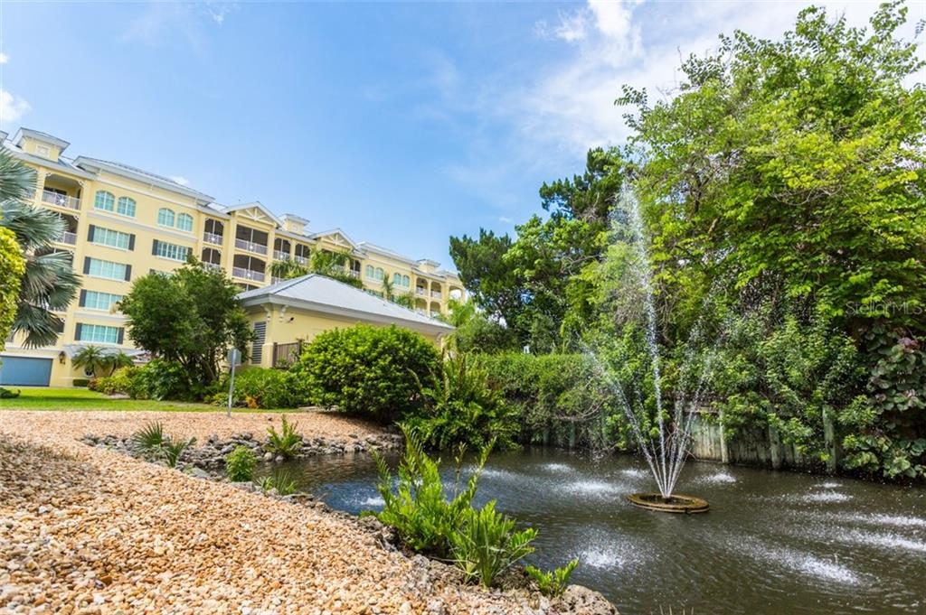 Beautifully landscaped grounds - Condo for sale at 1308 Old Stickney Point Rd #W24, Sarasota, FL 34242 - MLS Number is A4471155