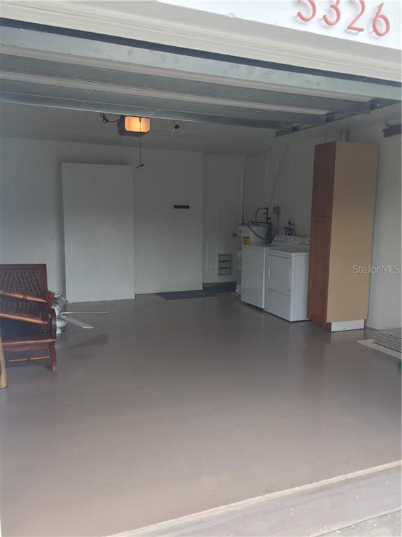 Garage with Washer/Dryer connection and Water Heater,  Door leads into Kitchen. - Single Family Home for sale at 5326 Colewood Pl, Sarasota, FL 34232 - MLS Number is A4471495