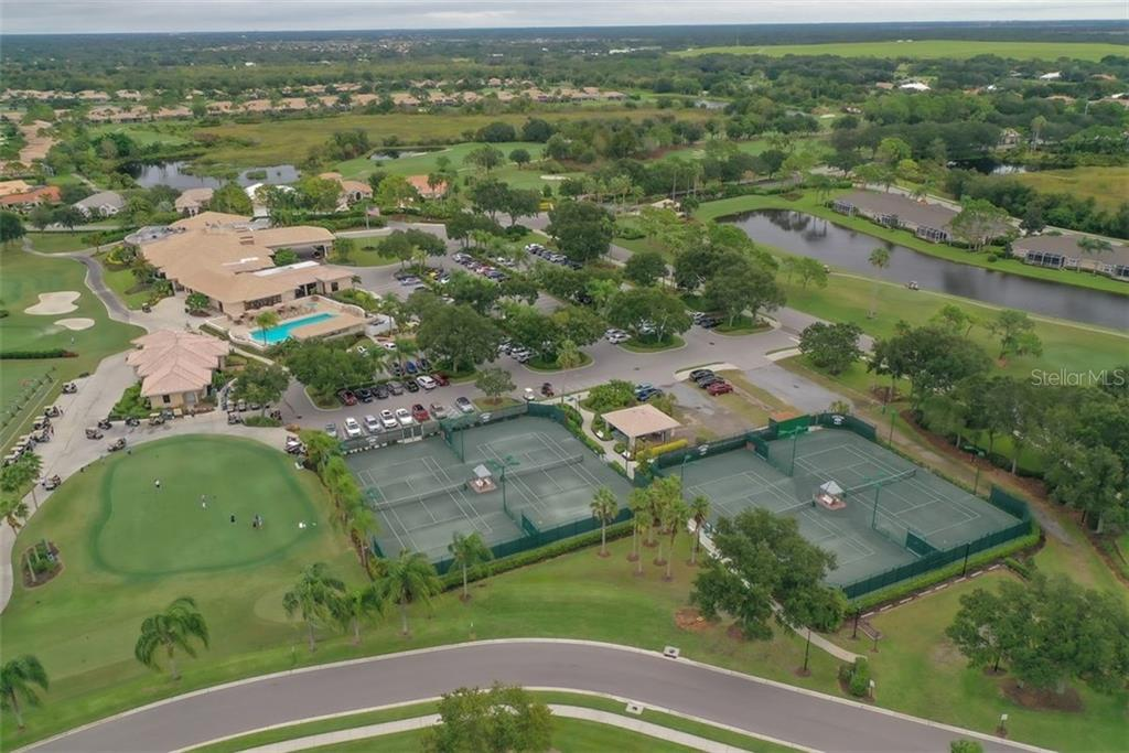 The sand hill cranes view of the tennis courts. - Villa for sale at 4590 Samoset Dr, Sarasota, FL 34241 - MLS Number is A4471881