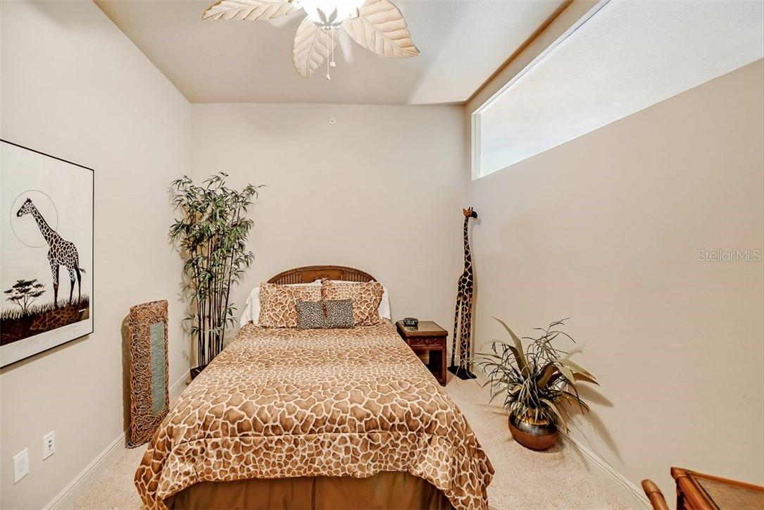 Bedroom with views of Sarasota bay and private terrace. Also including en suite bathroom and walk in closet space. - Condo for sale at 1300 Benjamin Franklin Dr #708, Sarasota, FL 34236 - MLS Number is A4471978