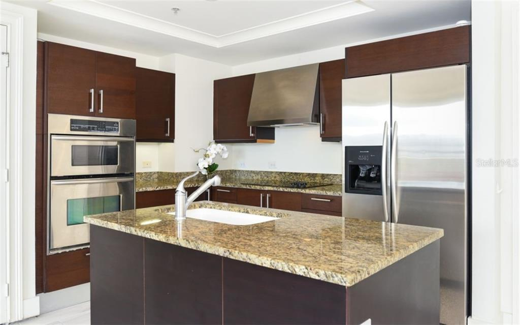 Kitchen with stainless steel appliances - Condo for sale at 1350 Main St #701, Sarasota, FL 34236 - MLS Number is A4472236