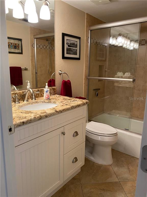 The guest bath has a tub & shower combination. - Condo for sale at 5770 Midnight Pass Rd #509c, Sarasota, FL 34242 - MLS Number is A4472645