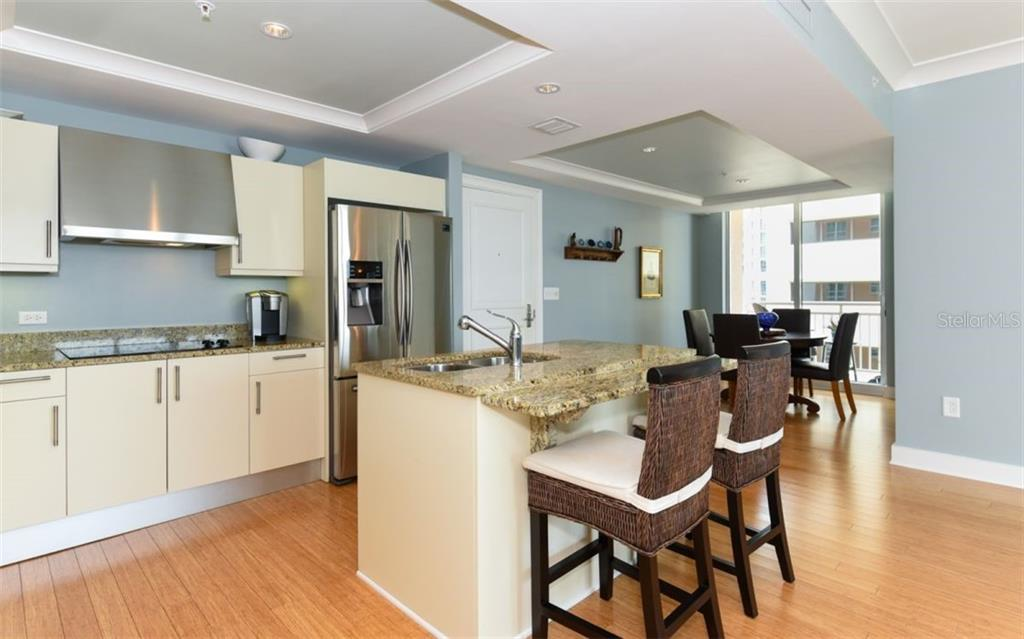 Looking toward the dining area - Condo for sale at 1350 Main St #1001, Sarasota, FL 34236 - MLS Number is A4472708