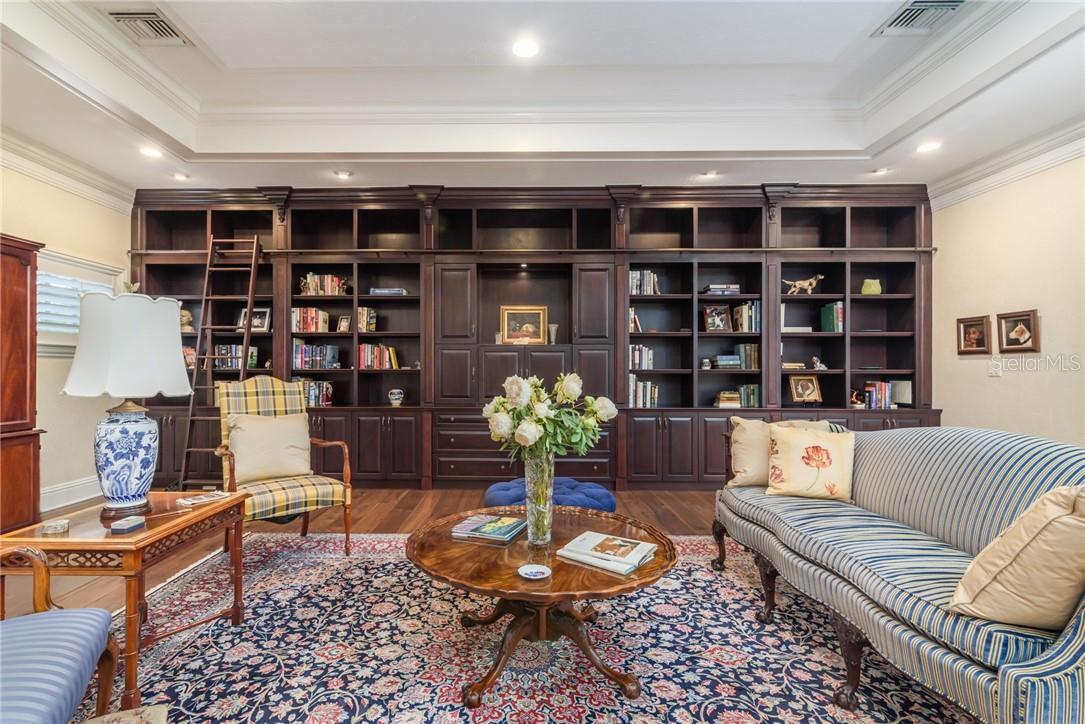 Upstairs luxurious custom cabinetry wall anchors the library with library ladder and plenty of room for your books and lounging possibilities. - Single Family Home for sale at 1807 Oleander St, Sarasota, FL 34239 - MLS Number is A4475067