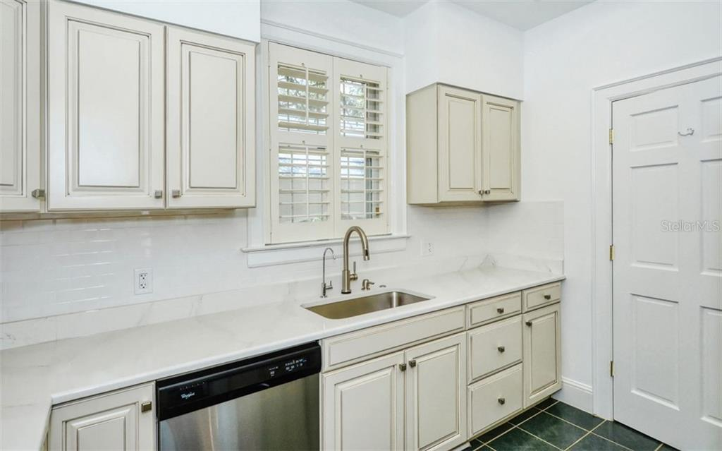 Kitchen - Condo for sale at 41 Bishops Court Rd #119, Osprey, FL 34229 - MLS Number is A4475081