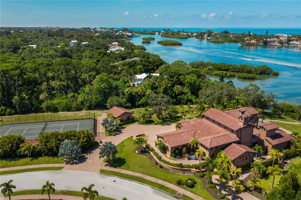 Home sits on just over 1.5 acres directly on Blackburn Bay and the Intracoastal Waterway with a private tennis court, an orchard, a second garage, and multiple courtyards. - Single Family Home for sale at 4925 Topsail Dr, Nokomis, FL 34275 - MLS Number is A4475116