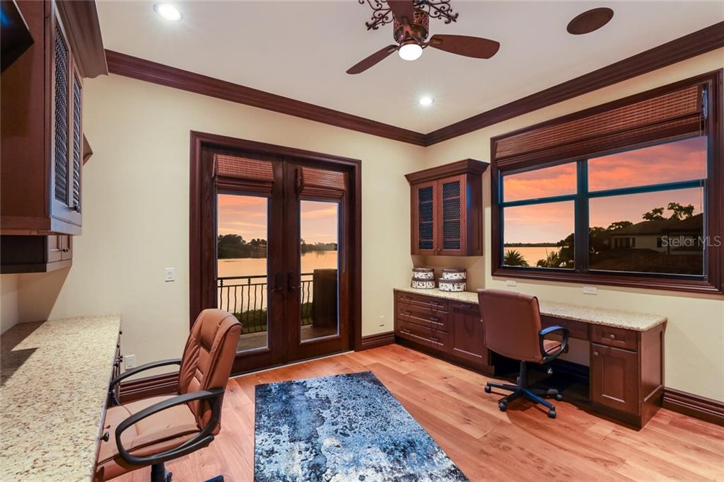 Upstairs room with a balcony and views of the water. This can be a 3rd bedroom/craft room/study/playroom. - Single Family Home for sale at 4925 Topsail Dr, Nokomis, FL 34275 - MLS Number is A4475116