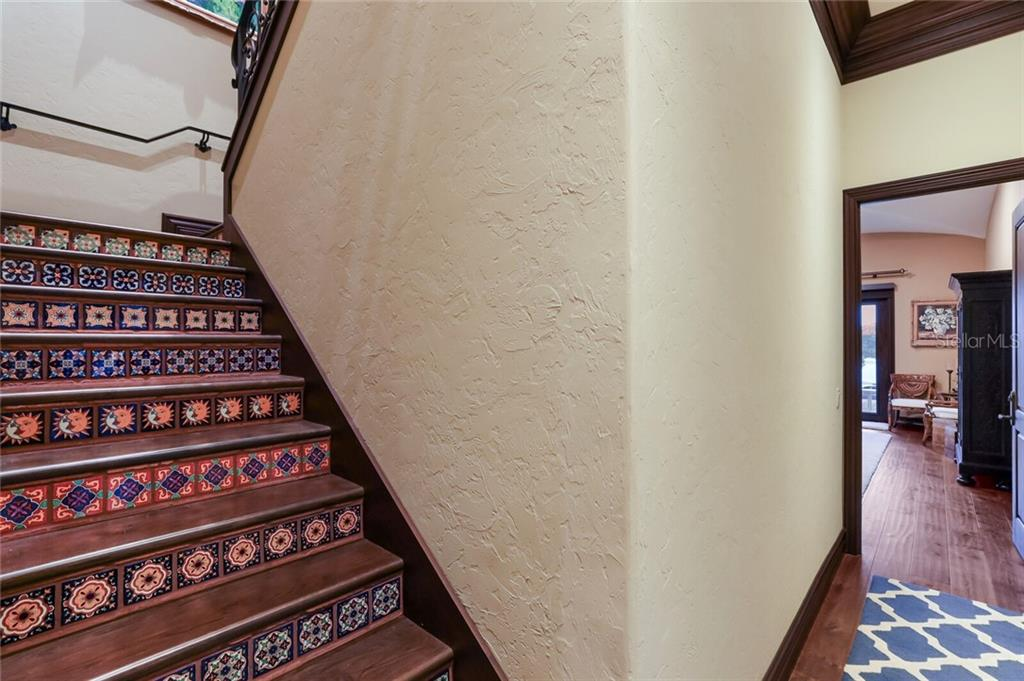 Staircase with tile insets to second story. Hall leads to the Master bedroom. - Single Family Home for sale at 4925 Topsail Dr, Nokomis, FL 34275 - MLS Number is A4475116