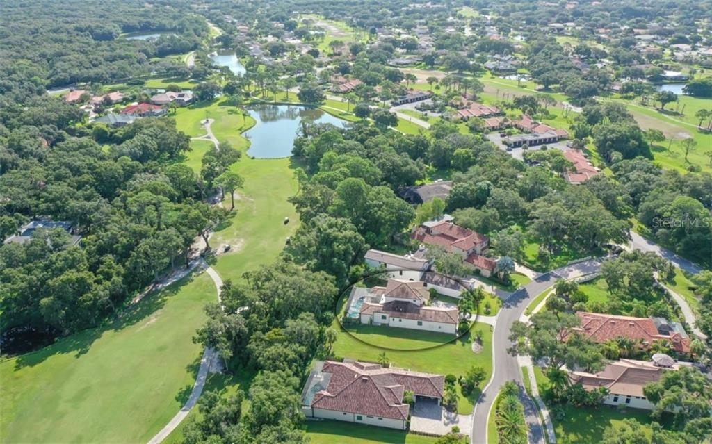 Trebor Lane is a private lane.  The rear of the home overlooks the 9th fairway of the Highlands Course. - Single Family Home for sale at 3538 Trebor Ln, Sarasota, FL 34235 - MLS Number is A4475545