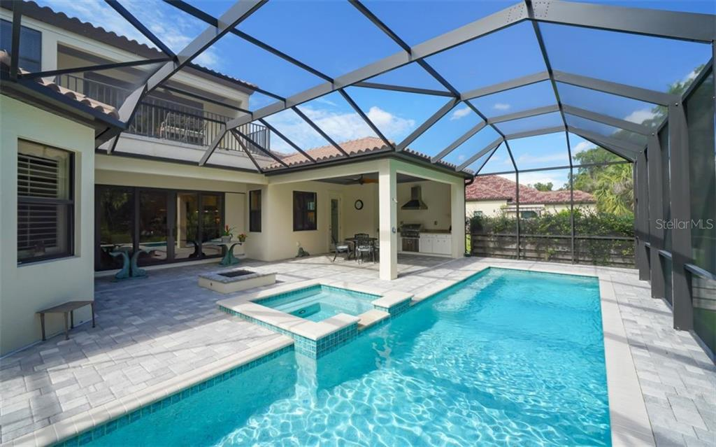 pool deck, lap pool with heated spa and fire pit.  Note covered outdoor kitchen and eating area.  Also: the outdoor shower offers both heated and cold water! - Single Family Home for sale at 3538 Trebor Ln, Sarasota, FL 34235 - MLS Number is A4475545