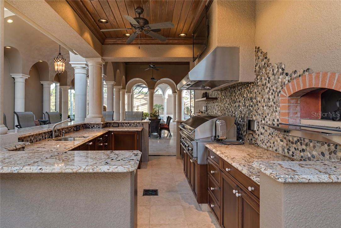 Custom Pizza Oven, Stainless Grill and River Pebble Backsplash - Single Family Home for sale at 8499 Lindrick Ln, Bradenton, FL 34202 - MLS Number is A4475594