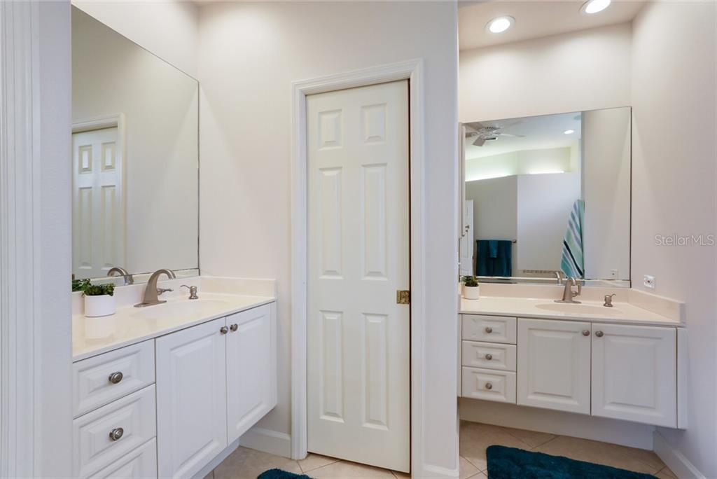 Two master vanities make for easy navigation, as well as a large linen closet (not pictured) and the water closet. - Single Family Home for sale at 9618 53rd Dr E, Bradenton, FL 34211 - MLS Number is A4477826
