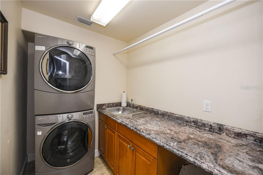 Laundry room. - Single Family Home for sale at 7303 Westmoreland Dr, Sarasota, FL 34243 - MLS Number is A4478376