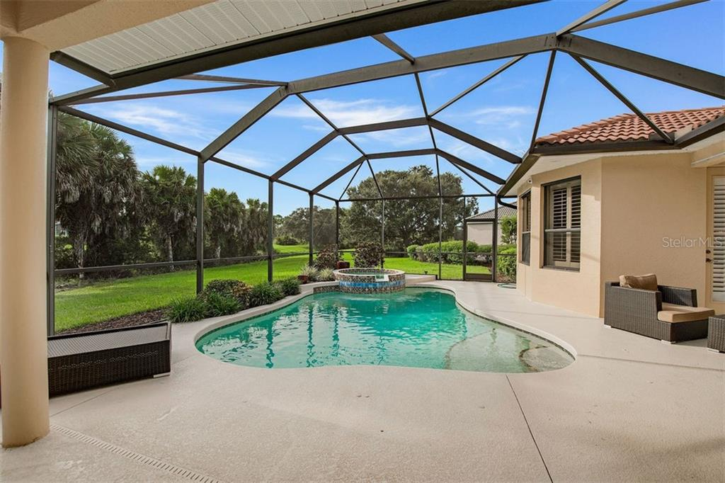 Pool and spa, heated with natural gas. - Single Family Home for sale at 684 Crane Prairie Way, Osprey, FL 34229 - MLS Number is A4478575
