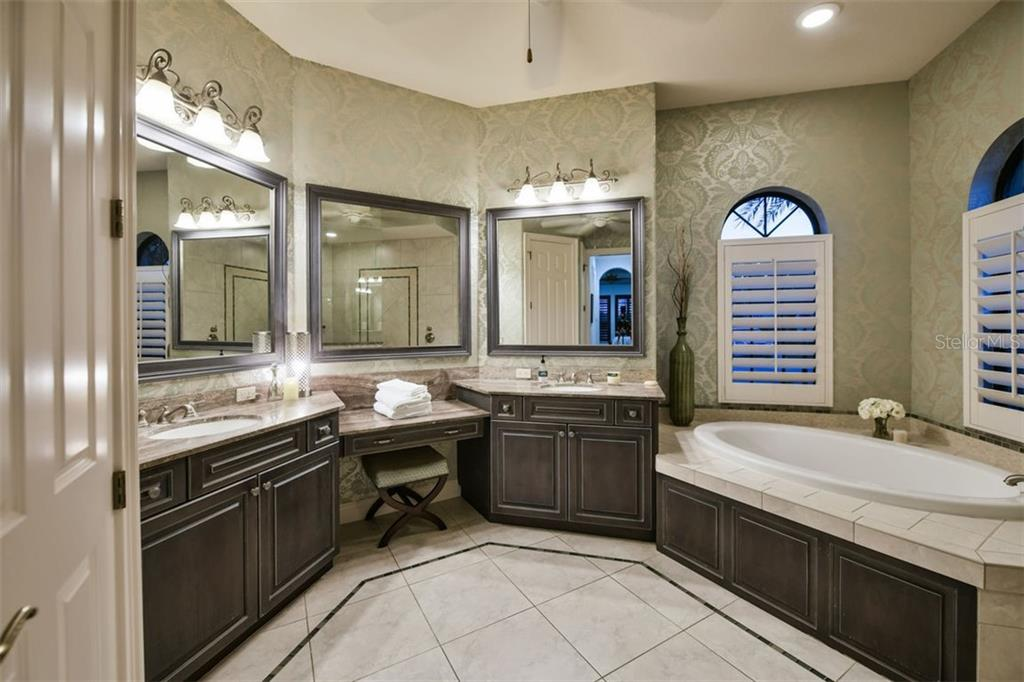 Master bathroom with dual sinks, makeup vanity, and garden tub - Single Family Home for sale at 14507 Leopard Crk, Lakewood Ranch, FL 34202 - MLS Number is A4478709