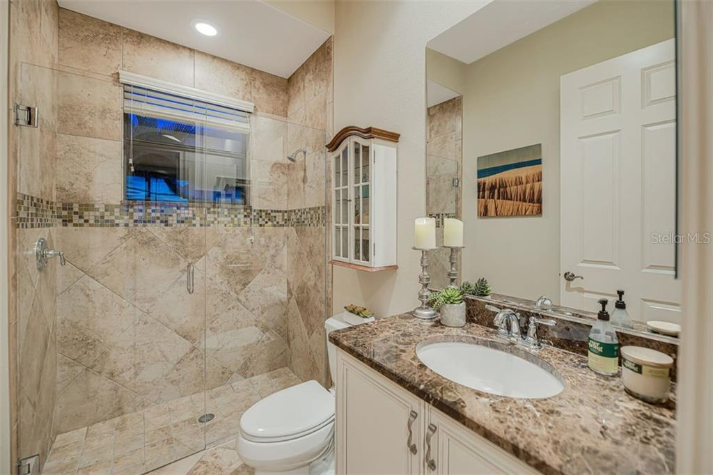 Bathroom 3, off of the 4th bedroom. granite counters and framless glass shower. - Single Family Home for sale at 14507 Leopard Crk, Lakewood Ranch, FL 34202 - MLS Number is A4478709