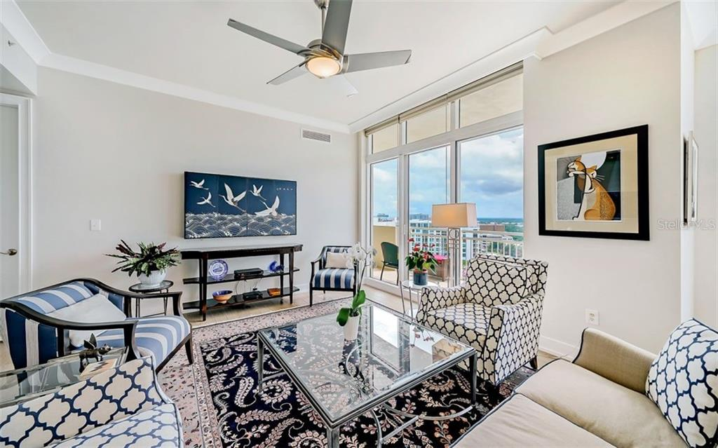 The spacious living area opens to a large terrace - Condo for sale at 1350 Main St #1601, Sarasota, FL 34236 - MLS Number is A4478753