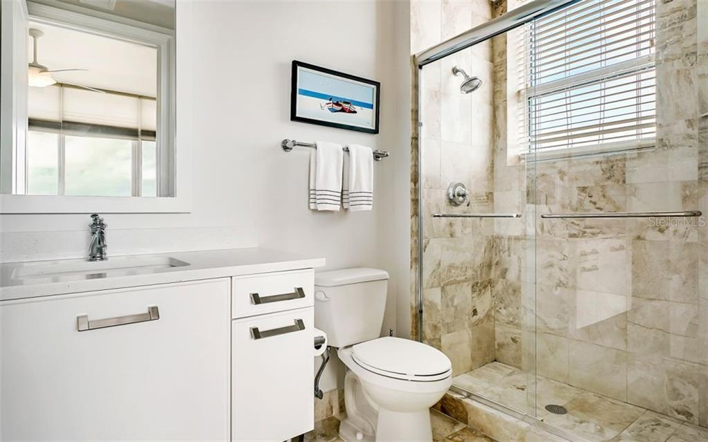 Suite # 1's ensuite bath with a walk-in shower - Condo for sale at 1350 Main St #1601, Sarasota, FL 34236 - MLS Number is A4478753