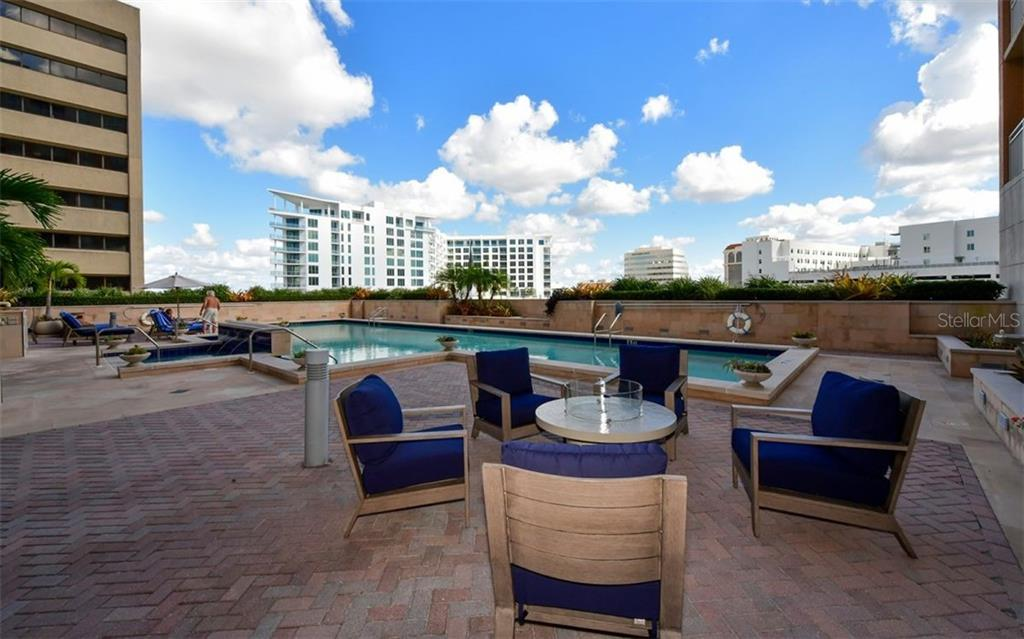Areas for relaxation around the pool - Condo for sale at 1350 Main St #1601, Sarasota, FL 34236 - MLS Number is A4478753