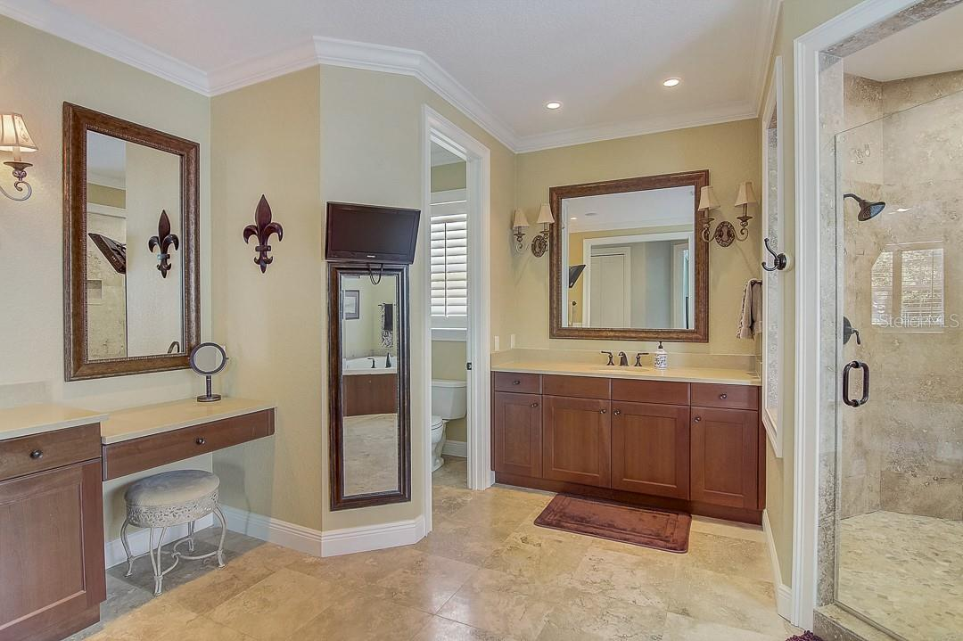 Vanity and private bathroom - Single Family Home for sale at 1839 Buccaneer Ct, Sarasota, FL 34231 - MLS Number is A4479580