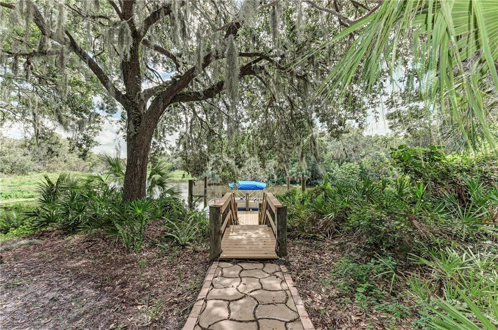 Walkway to your private boat deck - Single Family Home for sale at 7118 68th Dr E, Bradenton, FL 34203 - MLS Number is A4480398