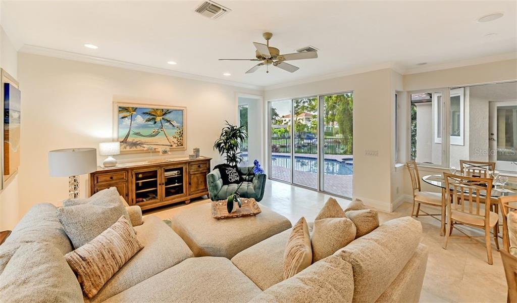 The kitchen nook & family room open to the  the pool & spa patio ! - Single Family Home for sale at 501 Cutter Ln, Longboat Key, FL 34228 - MLS Number is A4480484