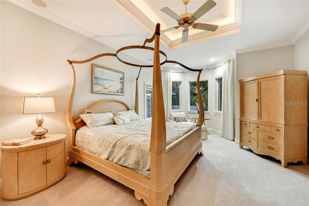 An elegant master suite with a private entrance from the patio - Single Family Home for sale at 501 Cutter Ln, Longboat Key, FL 34228 - MLS Number is A4480484