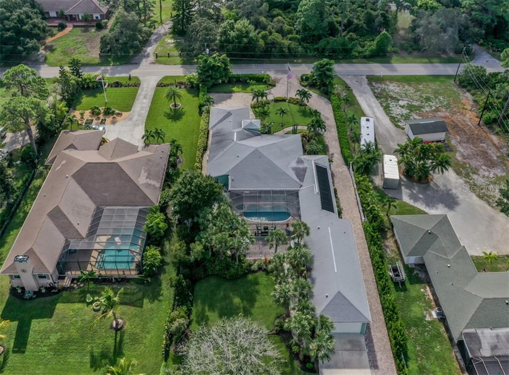 Aerial - Single Family Home for sale at 1395 Bayshore Dr, Englewood, FL 34223 - MLS Number is A4480508