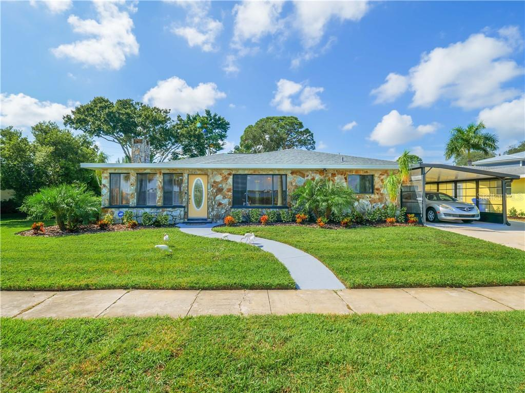 Beautifully landscaped yard.  Expansive water views from the living room, dining room, and kitchen windows. - Single Family Home for sale at 2408 Riverside Dr E, Bradenton, FL 34208 - MLS Number is A4480609