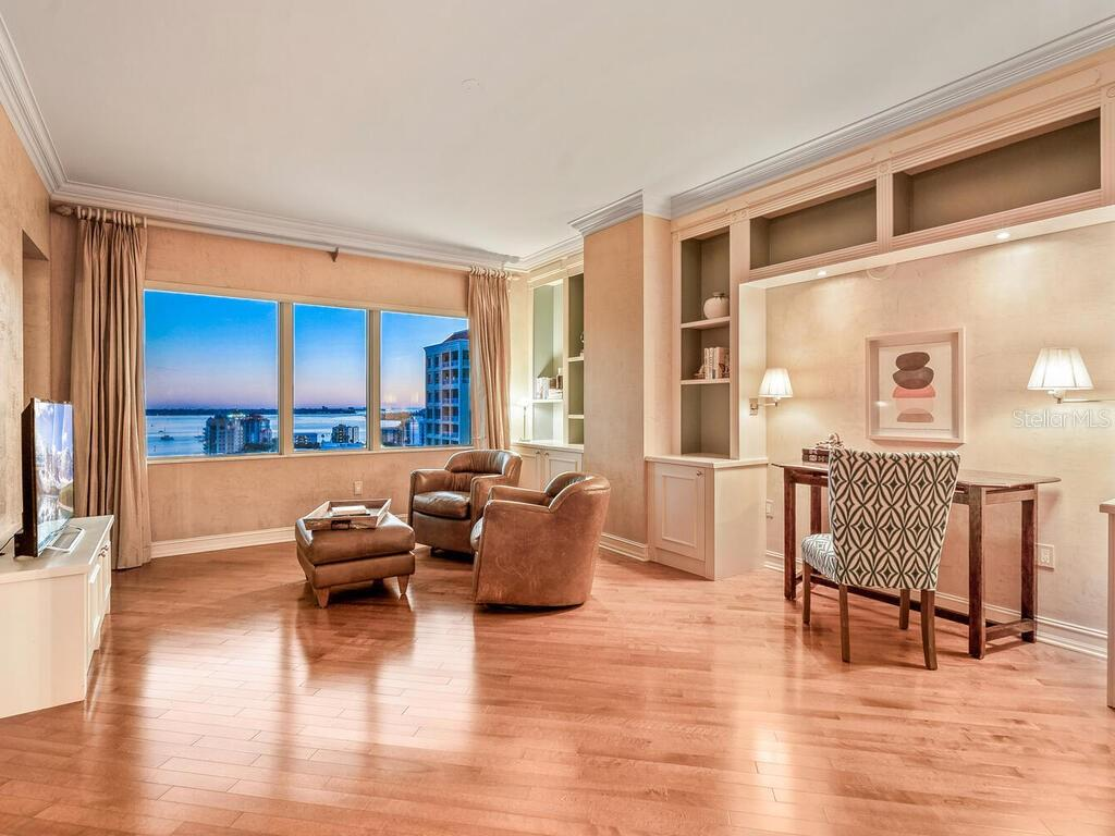 Water views while watching tv?  Yes, please!  And the built-in storage area is very useful too. - Condo for sale at 1111 Ritz Carlton Dr #1506, Sarasota, FL 34236 - MLS Number is A4480943