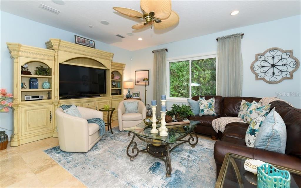 The spacious family room is located just off the kitchen and the perfect place to enjoy a evening movie after a day in the pool with family. - Single Family Home for sale at 1603 Landfall Dr, Nokomis, FL 34275 - MLS Number is A4480987