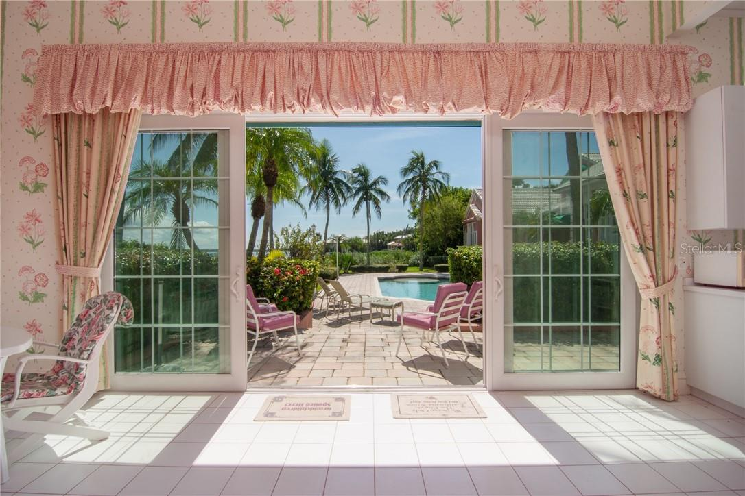Cabana looking out to patio and pool. - Single Family Home for sale at Address Withheld, Sarasota, FL 34242 - MLS Number is A4483403