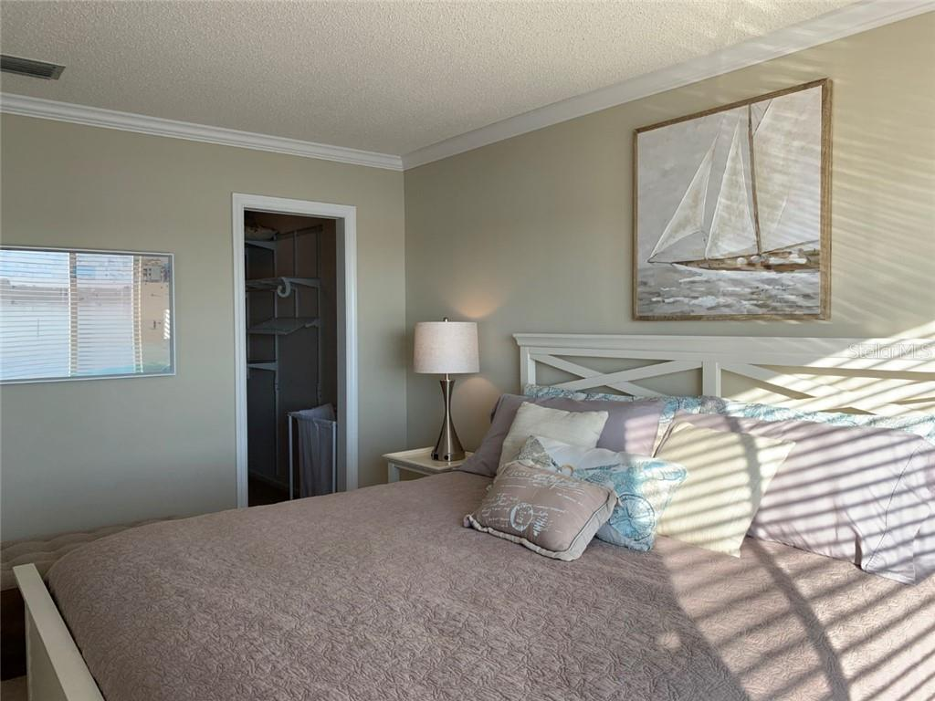 Master Bedroom with Walk-in Closet - Condo for sale at 9011 Midnight Pass Rd #328, Sarasota, FL 34242 - MLS Number is A4483601