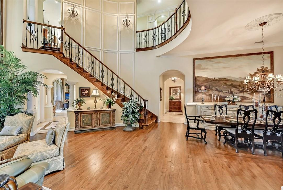Another view of this amazing property , you have two hallways to reach the kitchen or guest suites, note the 2 amazing sconces above the staircase. - Single Family Home for sale at 8263 Archers Ct, Sarasota, FL 34240 - MLS Number is A4483993