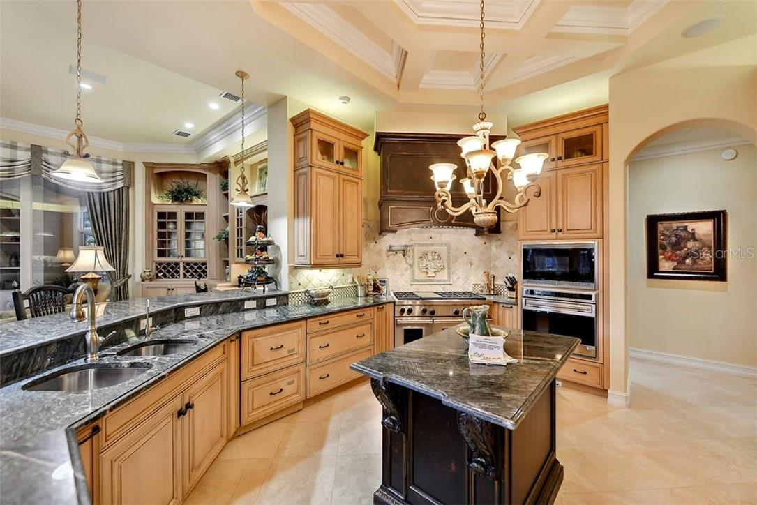 A gourmet's delight to cook on the gas 6 burner cooktop or the stainless steel Wolf ovens, Granite throughout all the surfaces - Single Family Home for sale at 8263 Archers Ct, Sarasota, FL 34240 - MLS Number is A4483993