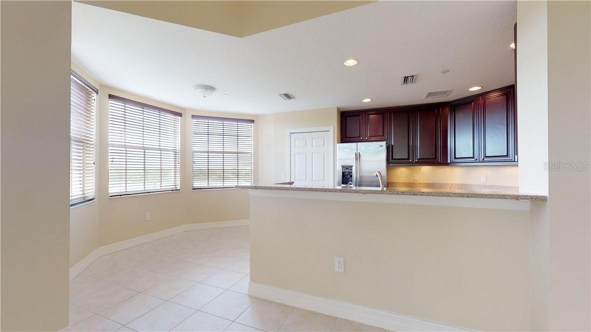 Dining space in kitchen - Condo for sale at 5591 Cannes Cir #506, Sarasota, FL 34231 - MLS Number is A4484243
