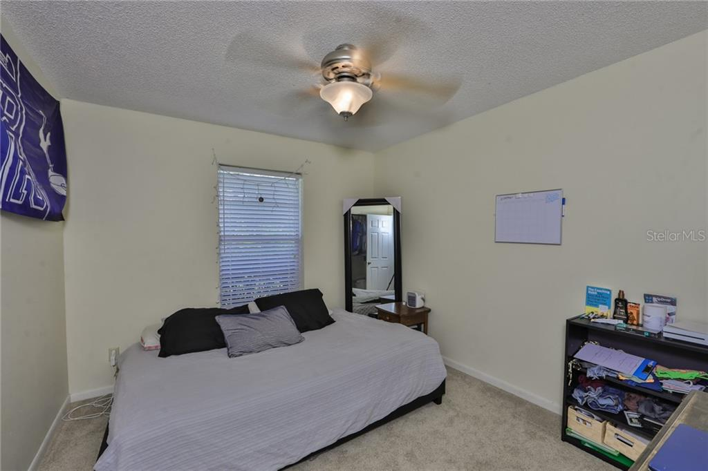 Guest Bedroom - Single Family Home for sale at 6215 Braden Run, Bradenton, FL 34202 - MLS Number is A4484627