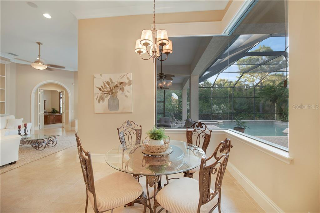 Eating space in kitchen with large aquarium windows - Single Family Home for sale at 13223 Palmers Creek Ter, Lakewood Ranch, FL 34202 - MLS Number is A4484826