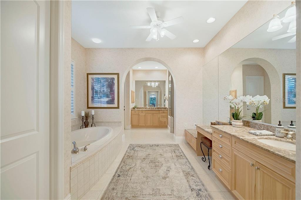 Master bath with dual vanities, walk-in frameless glass shower, and garden tub - Single Family Home for sale at 13223 Palmers Creek Ter, Lakewood Ranch, FL 34202 - MLS Number is A4484826