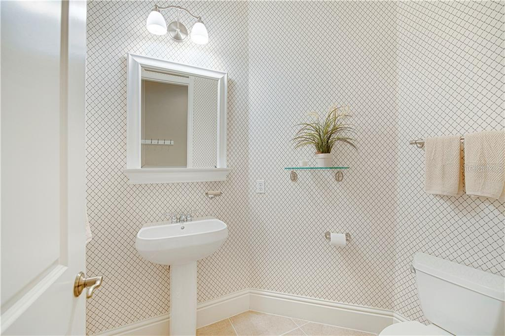 Half bath/powder room located across from the laundry room, near the garage entrance - Single Family Home for sale at 13223 Palmers Creek Ter, Lakewood Ranch, FL 34202 - MLS Number is A4484826