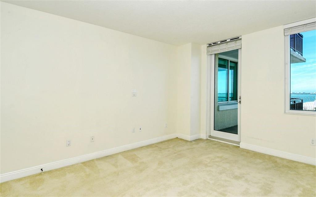 Master bath; dual sinks; walk in shower - Condo for sale at 800 N Tamiami Trl #1007, Sarasota, FL 34236 - MLS Number is A4485565